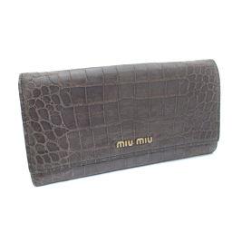 MIUMIU ミュウミュウ 二つ折り 長財布 型押しレザー パープル レディース【中古】